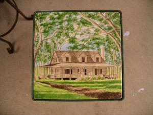 "Cabin on tile 8""x8"" set in wrought iron table"