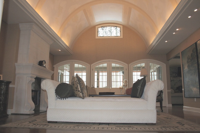 Vaulted living room detailed with stone arches